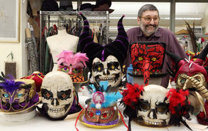 "Loquasto is shown with a collection of masks for the ""Mardi Gras"" portion of ""Station."""