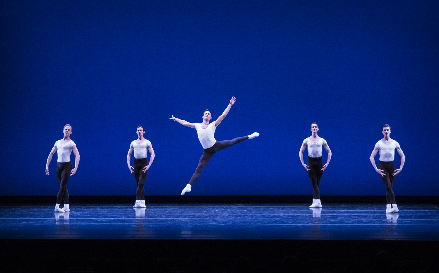 """Jerome Tisserand (jump), Dylan Wald, Guillaume Basso, Miles Pertl and Steven Loch (l-r) in Balanchine's """"Stravinsky Violin Concerto."""" Photo by Lindsay Thomas."""